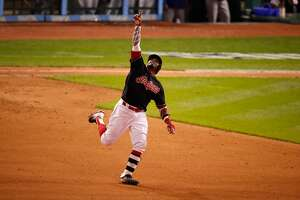CLEVELAND, OH - NOVEMBER 02:  Rajai Davis #20 of the Cleveland Indians celebrates after hitting a two-run home run during the eighth inning to tie the game 6-6 against the Chicago Cubs in Game Seven of the 2016 World Series at Progressive Field on November 2, 2016 in Cleveland, Ohio.  (Photo by Gregory Shamus/Getty Images)