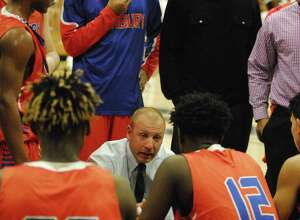 Danbury coach Casey Bock addresses his team during a timeout in a game against Staples on Tuesday.