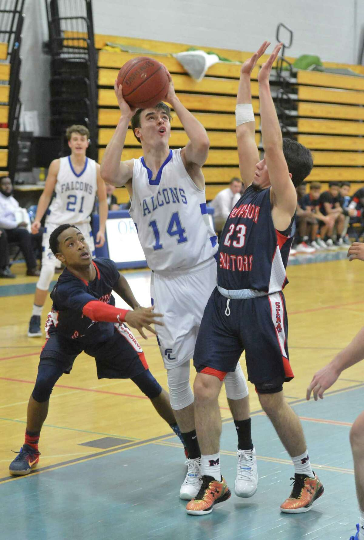 Fairfield Ludlowe's # 14 Ryan Keeley trys to get a shot vs Brien Mcmahon during boys basketball on Tuesday January 3, 2017 at Fairfield Ludlowe in Fairfield Conn.