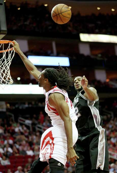 The ball didn't bounce the way of Nene and the Rockets in a loss to the Spurs on Nov. 12, but that's the night James Harden cites as when the team became fully attuned to coach Mike D'Antoni's preferred style of play. Photo: Yi-Chin Lee, Staff / © 2016  Houston Chronicle