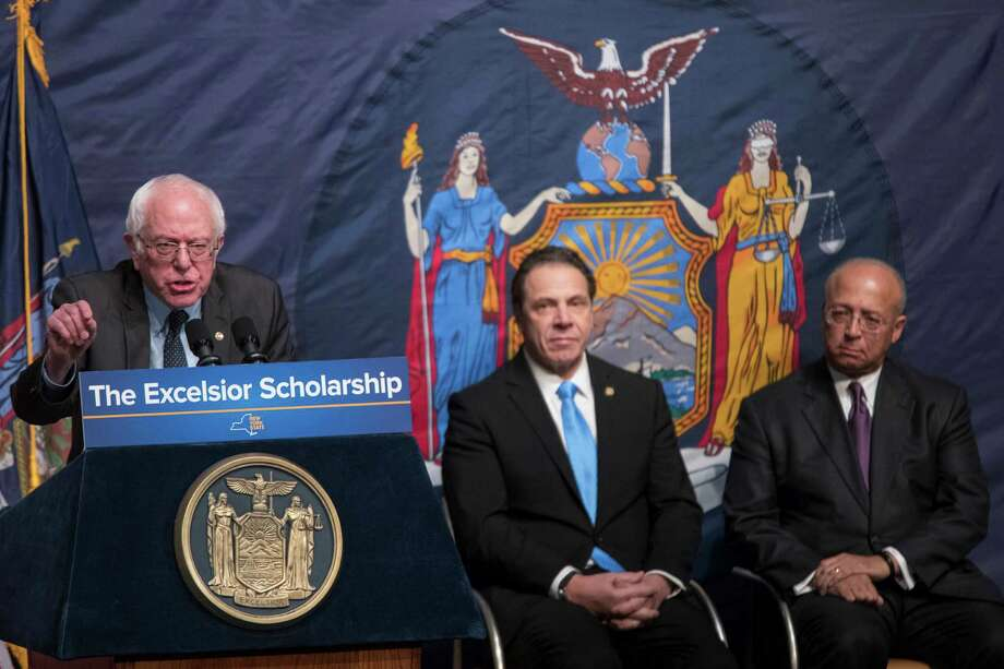 "New York Gov. Andrew Cuomo, center, and the chair of the City University of New York board, William  Thompson, right, listen as Sen. Bernie Sanders calls Cuomo's free tuition proposal ""revolutionary."" Photo: Mary Altaffer, STF / Copyright 2017 The Associated Press. All rights reserved."
