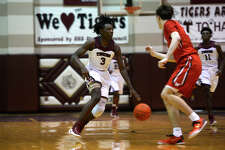 Silsbee's Devon McCain dribbles down court against The Woodlands on Tuesday evening. McCain suffered a concussion during last year's state final game. Photo taken Tuesday 1/3/17 Ryan Pelham/The Enterprise