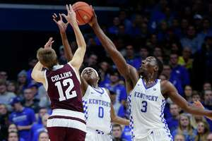 Kentucky's Bam Adebayo, right, blocks the pass of A&M's Chris Collins, a turnover that set up one of the Wildcats' many fast breaks.