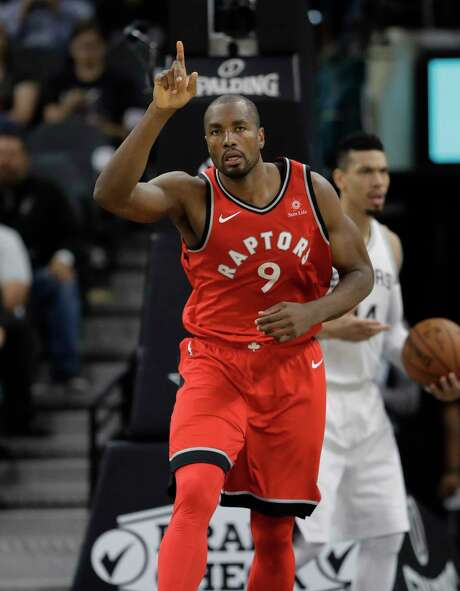 Toronto Raptors forward Serge Ibaka (9) reacts after a score during the second half of an NBA basketball game against the San Antonio Spurs, Monday, Oct. 23, 2017, in San Antonio. San Antonio won 101-97. (AP Photo/Eric Gay) Photo: Eric Gay, Associated Press / Copyright 2017 The Associated Press. All rights reserved.
