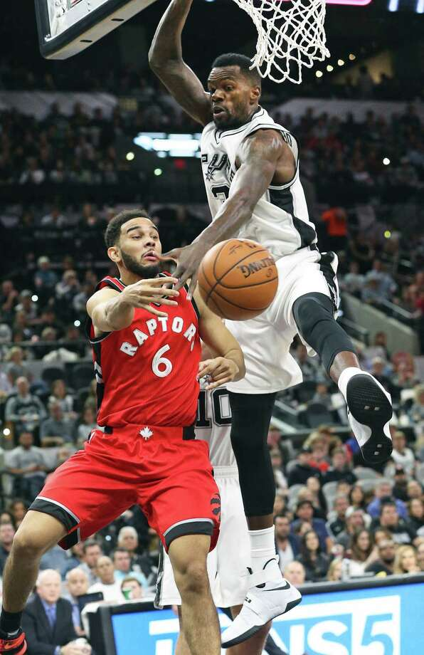 Dwayne Dedman forces Cory Joseph to pass to the outside as the Spurs play the Raptors at the AT&T Center on January 3, 2016. Photo: Tom Reel, San Antonio Express-News / 2017 SAN ANTONIO EXPRESS-NEWS