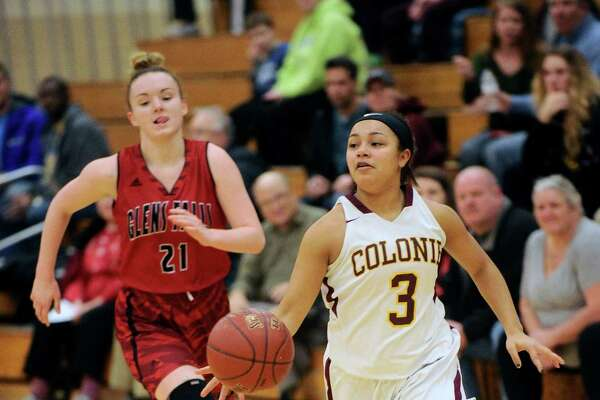 Colonie's Aiyah Wright (3) moves the ball past Glens Falls' Lucille Tougas (21) during the first half of a Section II girls' high school basketball game in Colonie, N.Y., Tuesday, Jan. 3, 2017. (Hans Pennink / Special to the Times Union) ORG XMIT: HP102