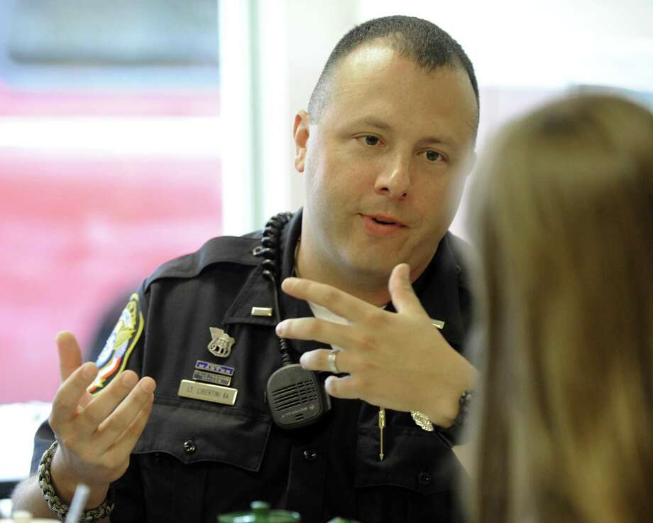 """File photo of Bethel Police Department's """"Coffee with a Cop"""" event on Aug. 10, 2016. Photo: Carol Kaliff / Carol Kaliff / The News-Times"""