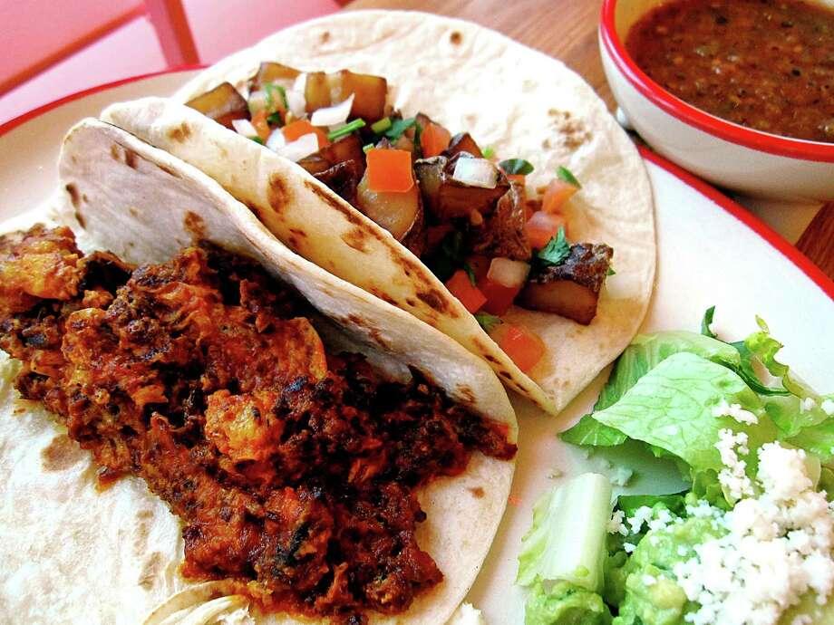 A taco with machacado con huevo and a papas rancheras taco from El Mirador. Photo: Mike Sutter /San Antonio Express-News