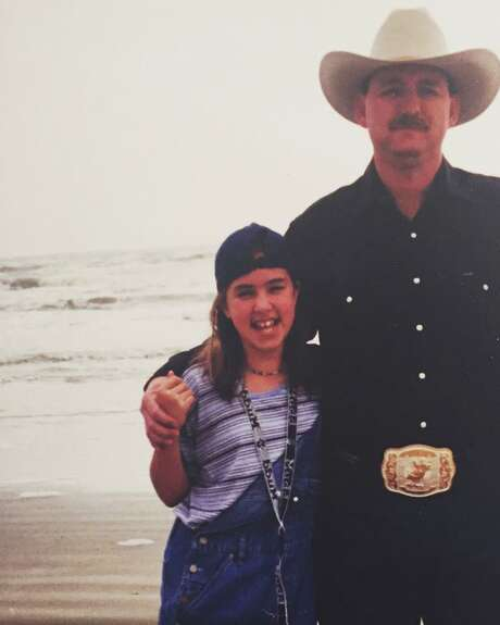 Driving through Galveston, my stepmom asked us to get out to take a photo at the beach. Obviously, my dad wouldn't wear a cowboy hat and belt buckle to the beach. BTW, he wasn't a bull rider. Where did he even get that buckle? Photo: Courtesy Jessica Hamilton