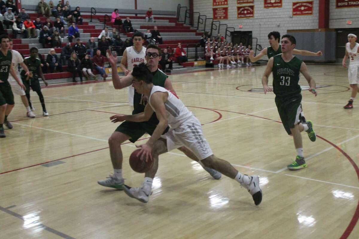 New Milford's Max Vaughey and Shane Fedigan work on defense against Wolcott.