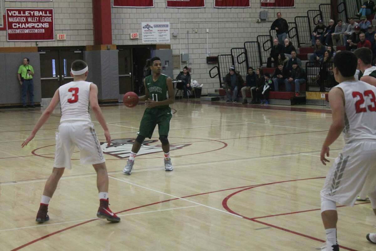 Matthew Brevard sets up the New Milford offense in a win against Wolcott.