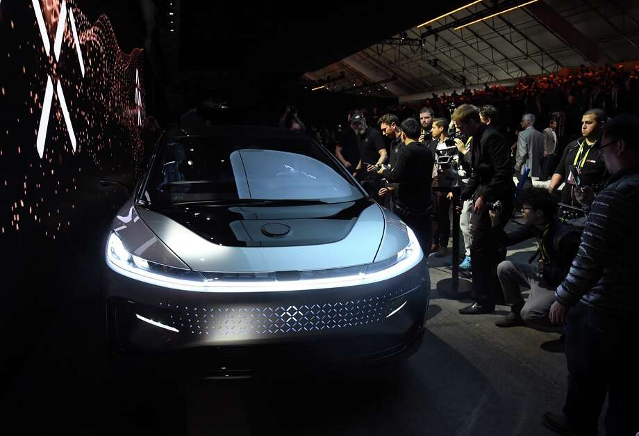 Attendees look at Faraday Future's FF 91 prototype electric crossover vehicle after it was unveiled during a press event for CES 2017 at The Pavilions at Las Vegas Market on January 3, 2017 in Las Vegas. The 1,050-horsepower FF 91 features autonomous driving with 3D lidar and can go from 0 to 60 mph in 2.39 seconds. CES, the world's largest annual consumer technology trade show, runs from January 5-8 and is expected to feature 3,800 exhibitors showing off their latest products and services to more than 165,000 attendees.  Photo: Ethan Miller/Getty Images