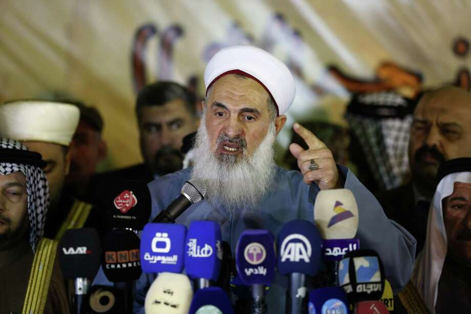 The Mufti of the Sunni Community in Iraq Sheikh Mehdi al-Sumaidaie speaks to media outlets in Baghdad, Iraq, Tuesday, January 3, 2017. Violence claimed the lives of at least 6,878 civilian Iraqis last year, the United Nations said on Monday, as the Iraqi government struggles to maintain security nationwide and to dislodge Islamic State group militants from areas under their control. (AP Photo/ Karim Kadim) Photo: Karim Kadim, STF / Associated Press / Copyright 2017 The Associated Press. All rights reserved.
