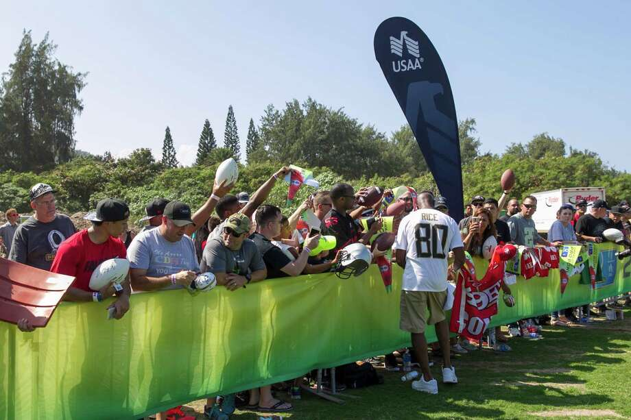 NFL legend Jerry Rice signs autographs for wounded veterans during the 2016 NFL Pro Bowl practice presented by USAA on Friday, Jan. 29, 2016 at Turtle Bay Resort in Kahuku, Hawaii.  USAA is the Official Military Appreciation Sponsor of the NFL.  (Marco Garcia/AP Images for USAA) Photo: Marco Garcia, Associated Press / AP Images