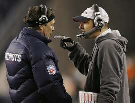 New England Patriots head coach Bill Belichick, left, talks with Patriots offensive coordinator Josh McDaniels after the Patriots scored their first touchdown during first quarter action of their NFL football game against the Pittsburgh Steelers in Foxborough, Mass. on Sunday, Dec. 9, 2007. (AP Photo/Stephan Savoia)