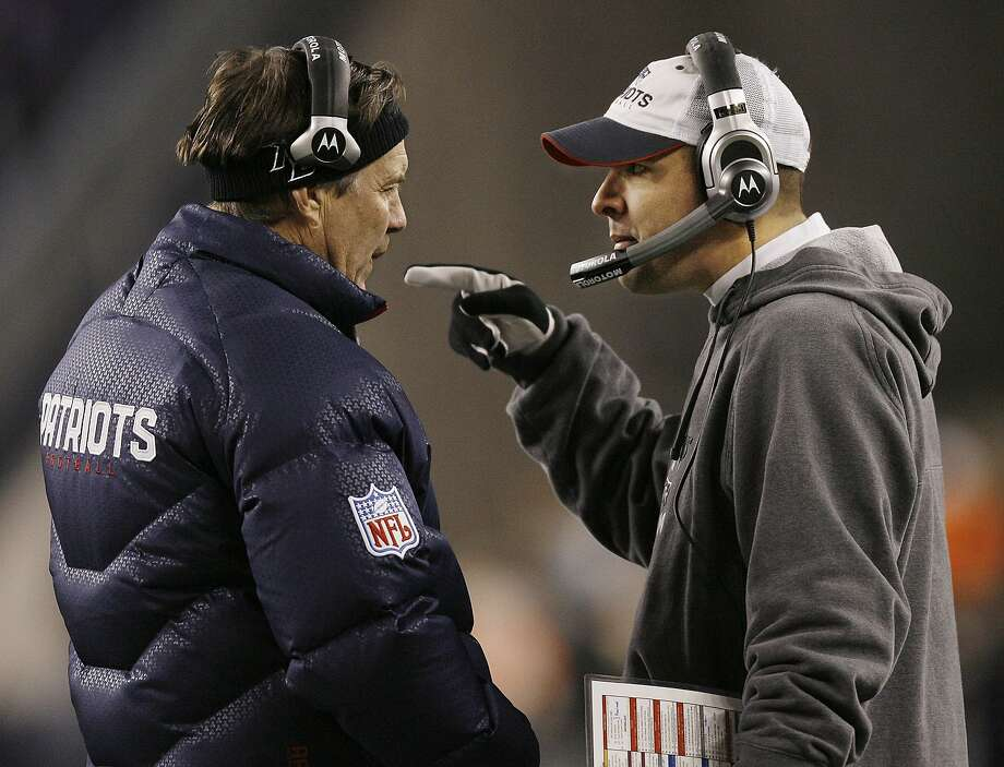 Bill Belichick (left) with Patriots offensive coordinator Josh McDaniels. Photo: Winslow Townson, AP