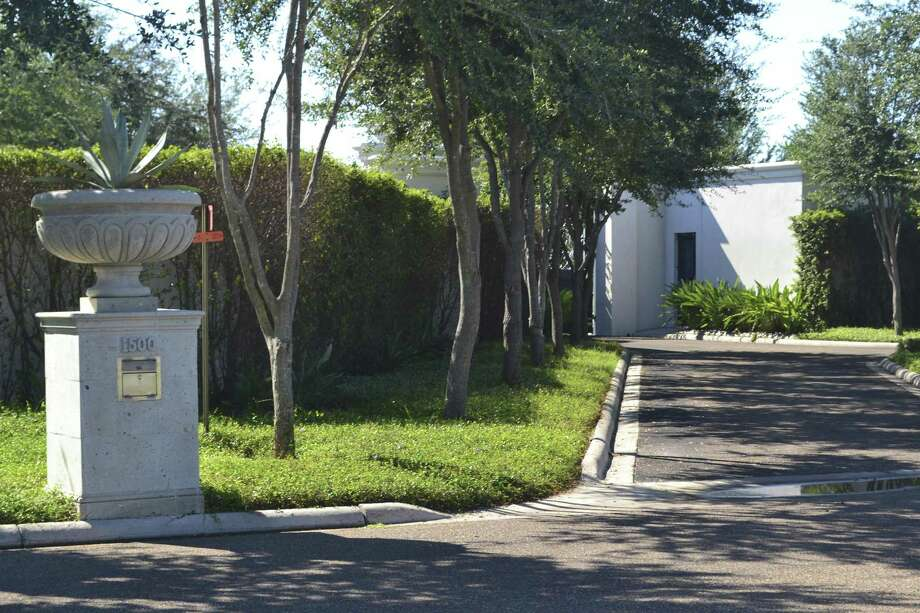 The entrance to Luis Carlos Castillo Cervantes's compound in Mission. The property, which includes a 25,000-square-foot house and an 8,000-square-foot entertainment facility, is appraised at $3 million. Castillo pleaded guilty on Jan. 3, 2017, to one count of money laundering conspiracy. Photo: Jason Buch, Staff Photographer / San Antonio Express-News / San Antonio Express-News