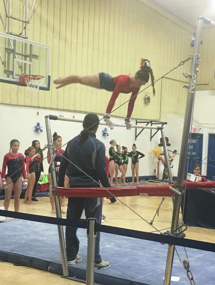 Darien Level 5 gymnast Sofia Imbrogno scored 9.25 to win the bars title for her age group at the Snowflake Invitational in Wilton. Photo: Contributed Photo / Darien News contributed