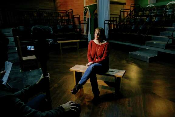"Jennifer Decker, director of ""The Johns,"" a play exploring sex trafficking, talks about the play while filming a promotional video Tuesday, Dec. 20, 2016, in Houston."