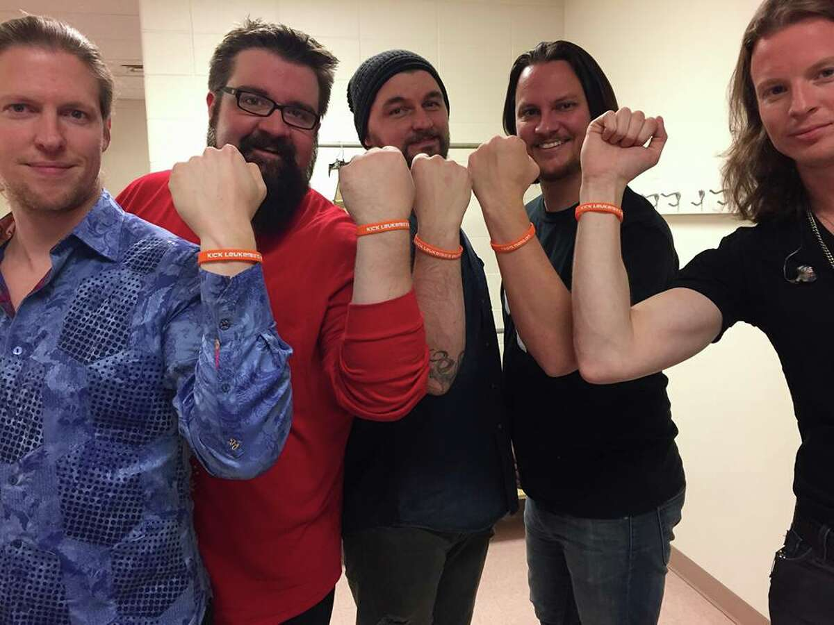 Mahlon Hardt, of Nederland, died Tuesday after a year-long battle with Acute Myeloid Leukemia. Hardt gained a lot of local support during his battle. Above is local artist, Tim Foust, with his a capella group 'Home Free' wearing 'Team Mahlon' bracelets.