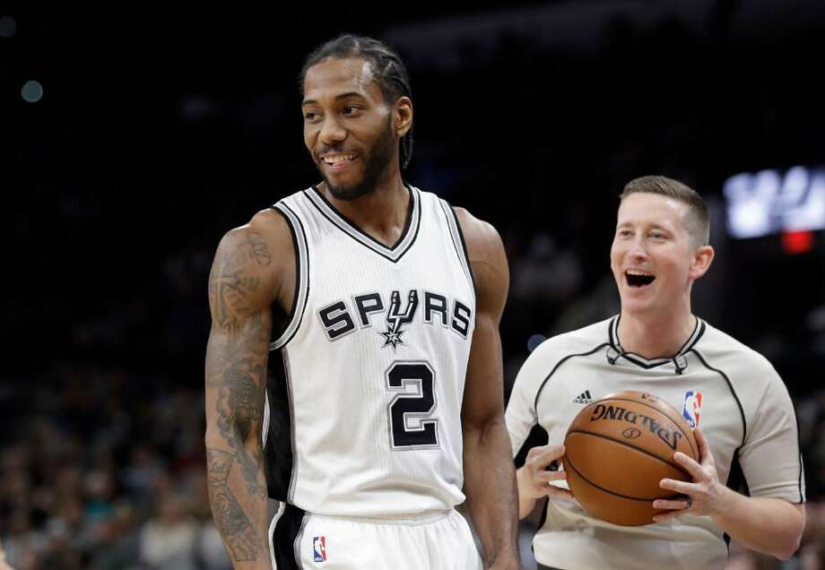 Kawhi Leonard and referee Nick Buchert are all smiles during the Spurs' 110-82 rout of Toronto Tuesday at the AT&T Center. Photo: /
