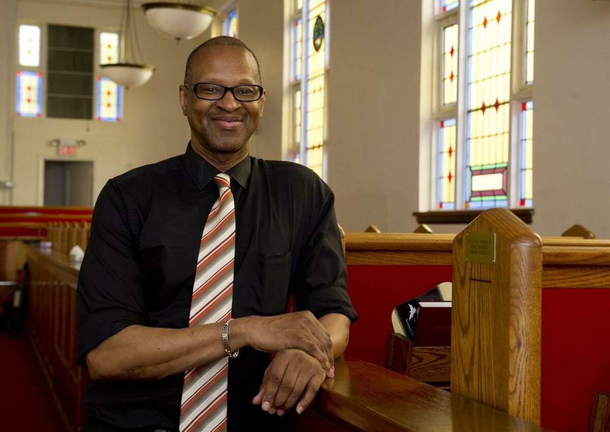 FILE - Jack Bryant, president of the Stamford chapter of the NAACP, poses for a photo at Faith Tabernacle Missionary Baptist Church in Stamford, Conn., on Friday, June 13, 2014.