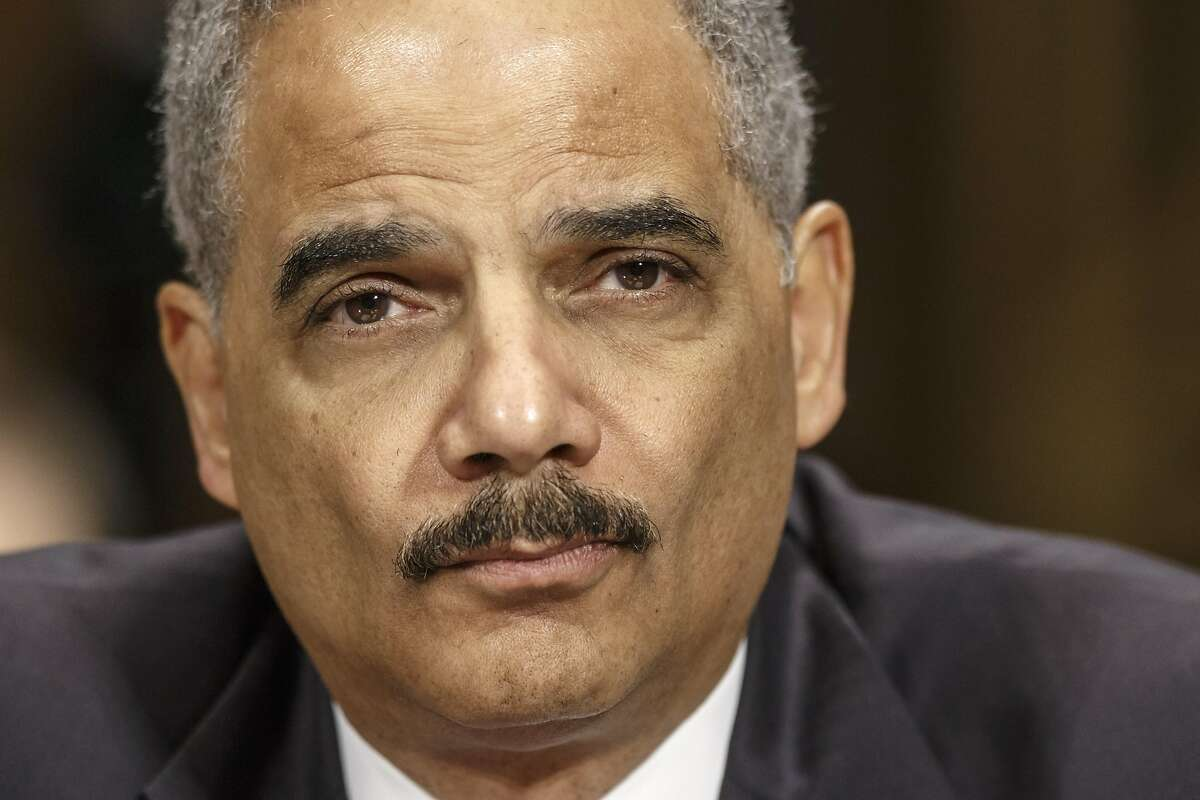 Former U.S. Attorney General Eric Holder, seen in 2014, has been hired by the California Legislature o advise members regarding potential conflicts with the incoming Trump administration.