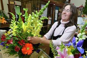 Floral Designer Ann Brueggmann places some Snapdragons into a mixed arrangement while working an order for a client at City Line Florist on Nichols Ave. on the Stratford Trumbull line on Wednesday January 4, 2017 in Trumbull Conn. The business offers custom made and ready to go flowers, plants and gifts and will celebrate a fourth generation family owned business milestone anniversary of 100 years in 2018.