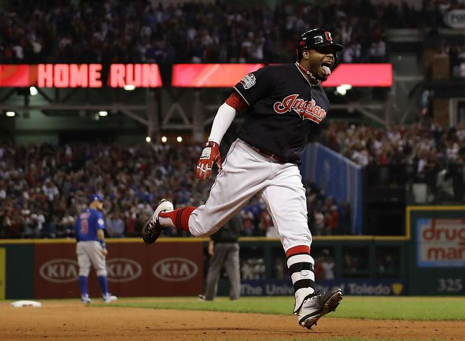 This Nov. 2, 2016 file photo shows Cleveland Indians' Rajai Davis celebrating after his two-run home run against the Chicago Cubs during the eighth inning of Game 7 of the Major League Baseball World Series in Cleveland. After a World Series trip with Cleveland, Davis is returning to the Bay Area with the Oakland Athletics on a $6 million, one-year contract to fill a void in center field. (AP Photo/Matt Slocum, file) Photo: Matt Slocum, Associated Press
