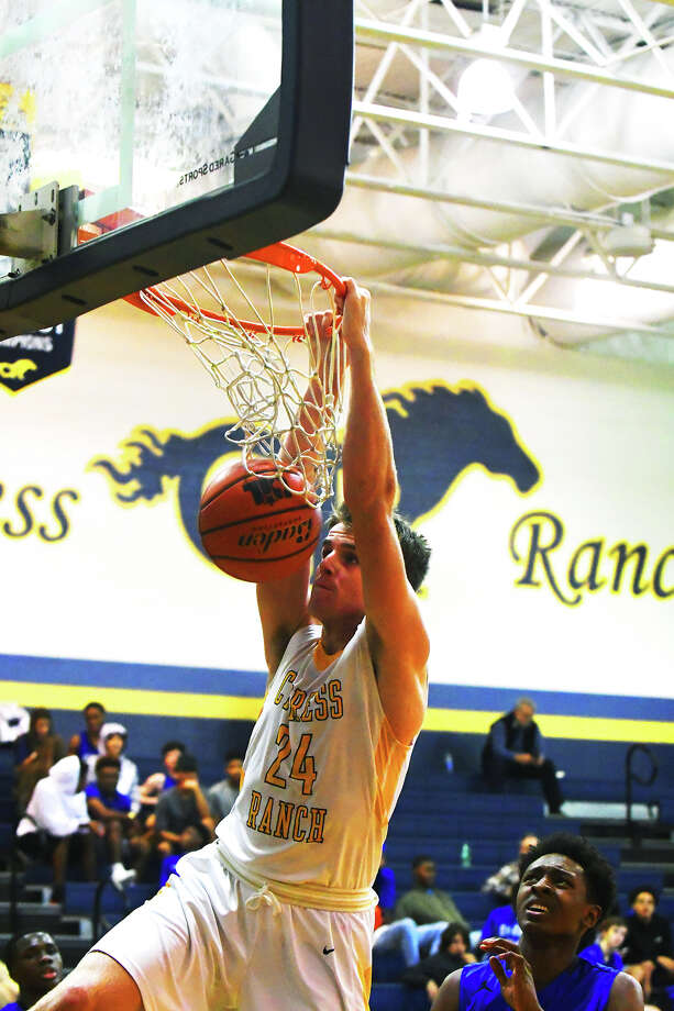 Cy Ranch senior guard Blake Nevins throws it down Tuesday against Cy Creek in the district opener. Nevins' Mustangs won 71-64 and Nevins scored 24 points in the victory. Photo: Tony Gaines / HCN
