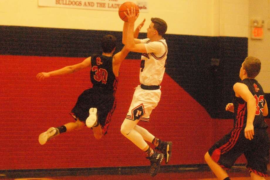 Plainview's Bryson DeBerry pulls up for a short jumpshot as an opponent goes past him during a game earlier this season. The 6-foot-5 senior scored 11 points, but Amarillo handed the Bulldogs their first District 3-5A loss. Photo: Skip Leon/Plainview Herald