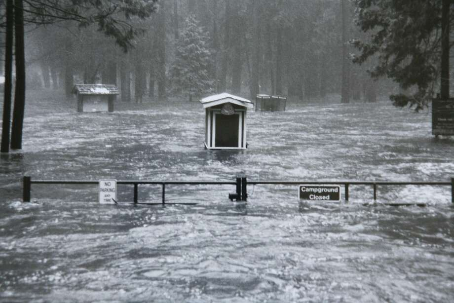 A National Park Service file photo showing the entrance to Lower River Campgrounds on January 2, 1997. Twenty years ago on January 1-3, 1997, heavy rain and warm temperatures on top of a heavy snowpack on the peaks surrounding Yosemite Valley caused the greatest flood ever seen in Yosemite since gauging stations were first installed on the Merced River over 80 years ago. The valley lost approximately half of its campsites (about 350), 200 concession employee housing units, over 50% of accommodations at the Yosemite Lodge, and 33 backcountry bridges. The valley was closed for two and a half months for repairs that are still going on today. Photo courtesy of the National Park Service. Photo: National Park Service, SFC