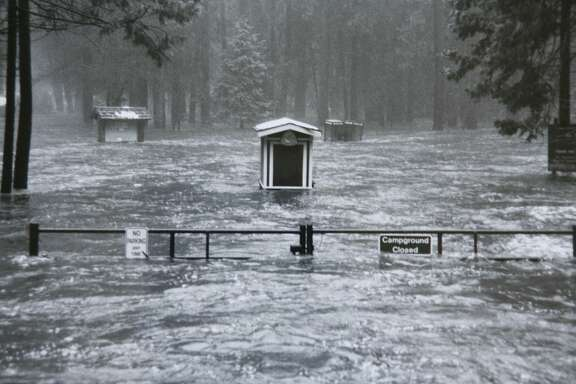 A National Park Service file photo showing the entrance to Lower River Campgrounds on January 2, 1997. Twenty years ago on January 1-3, 1997, heavy rain and warm temperatures on top of a heavy snowpack on the peaks surrounding Yosemite Valley caused the greatest flood ever seen in Yosemite since gauging stations were first installed on the Merced River over 80 years ago. The valley lost approximately half of its campsites (about 350), 200 concession employee housing units, over 50% of accommodations at the Yosemite Lodge, and 33 backcountry bridges. The valley was closed for two and a half months for repairs that are still going on today. Photo courtesy of the National Park Service.