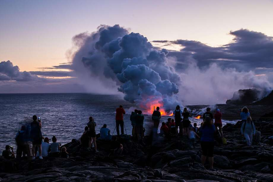 Although hiking is more difficult at night, the sight of lava entering the ocean is worth the effort. Photo: J. Wei / NPS