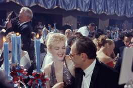 Married American couple actress Marilyn Monroe (born Norma Jeane Mortenson, 1926 - 1962) and playwright Arthur Miller (1915 - 2005) share a laugh as they attend the 'April in Paris Ball' at the Waldorf Astoria, New York, New York, April 11, 1957. (Photo by Peter Stackpole/The LIFE Picture Collection/Getty Images)