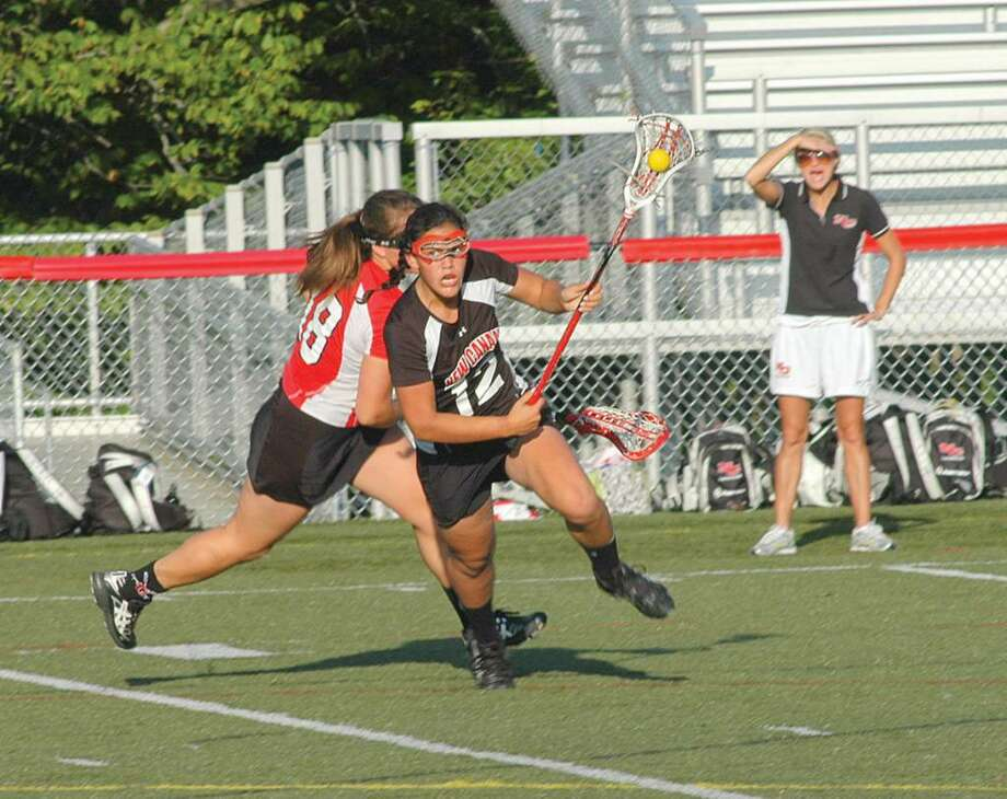 Anjalie Christie turns the corner during the second half of Monday's Rams playoff win over Greenwich. Photo: Andy Hutchison / Contributed Photo, Contributed Photo / New Canaan News