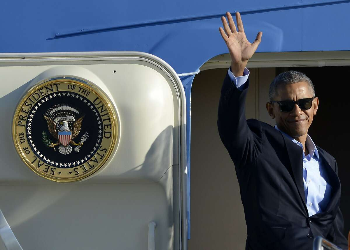 """FILE - In this Oct. 9, 2016 file photo, President Barack Obama, wearing sunglasses, waves while boarding Air Force One before leaving O'Hare International Airport in Chicago. From his campaign fist bump to his theatrical mic drop at the last White House correspondents' dinner, Barack Obama ruled as America's pop culture president. His two terms played out like a running chronicle of the trends of our times: slow-jamming the news with Jimmy Fallon, reading mean tweets with Jimmy Kimmel, filling out his NCAA basketball bracket on ESPN, cruising with Jerry Seinfeld on """"Comedians in Cars Getting Coffee."""" (AP Photo/Paul Beaty, File)"""