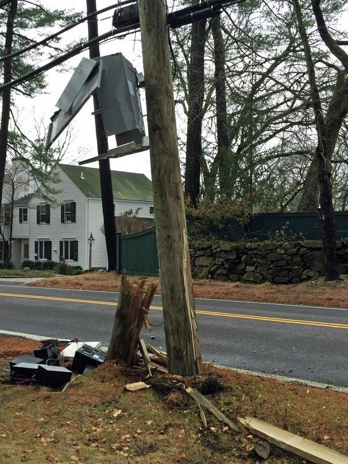 A car struck a telephone pole by Stanwich School about noon, cleaving a utility pole in two and closing the road. Photo: Contributed