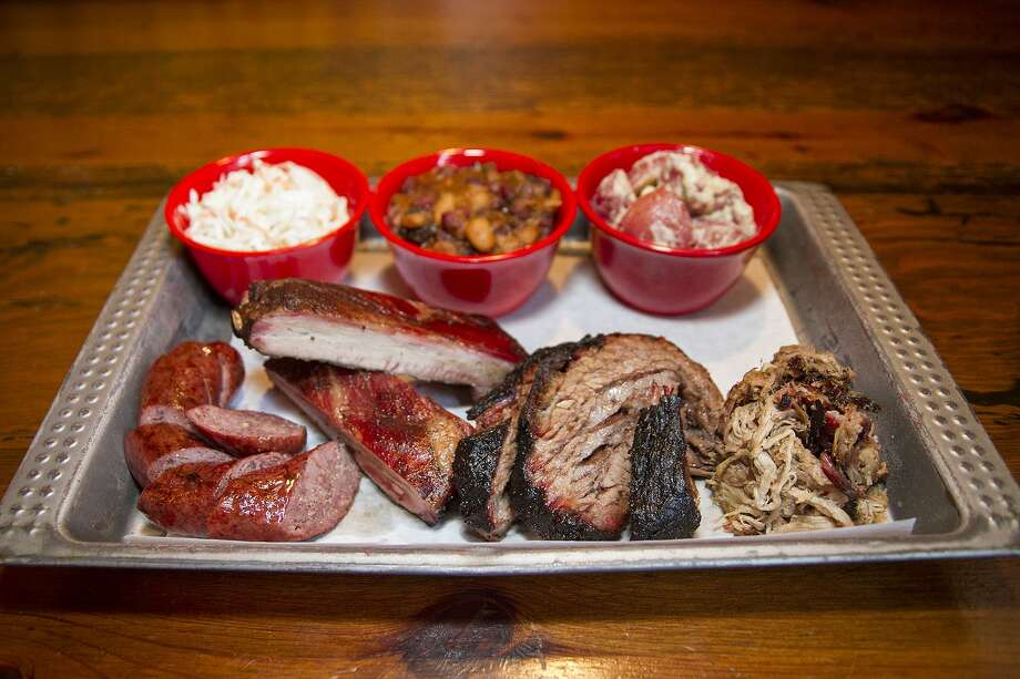A barbecue lunch at The Granary 'Cue and Brew might include sausage, pork ribs, brisket, pulled pork, cole slaw, beans and potato salad. Photo: Express-News File Photo