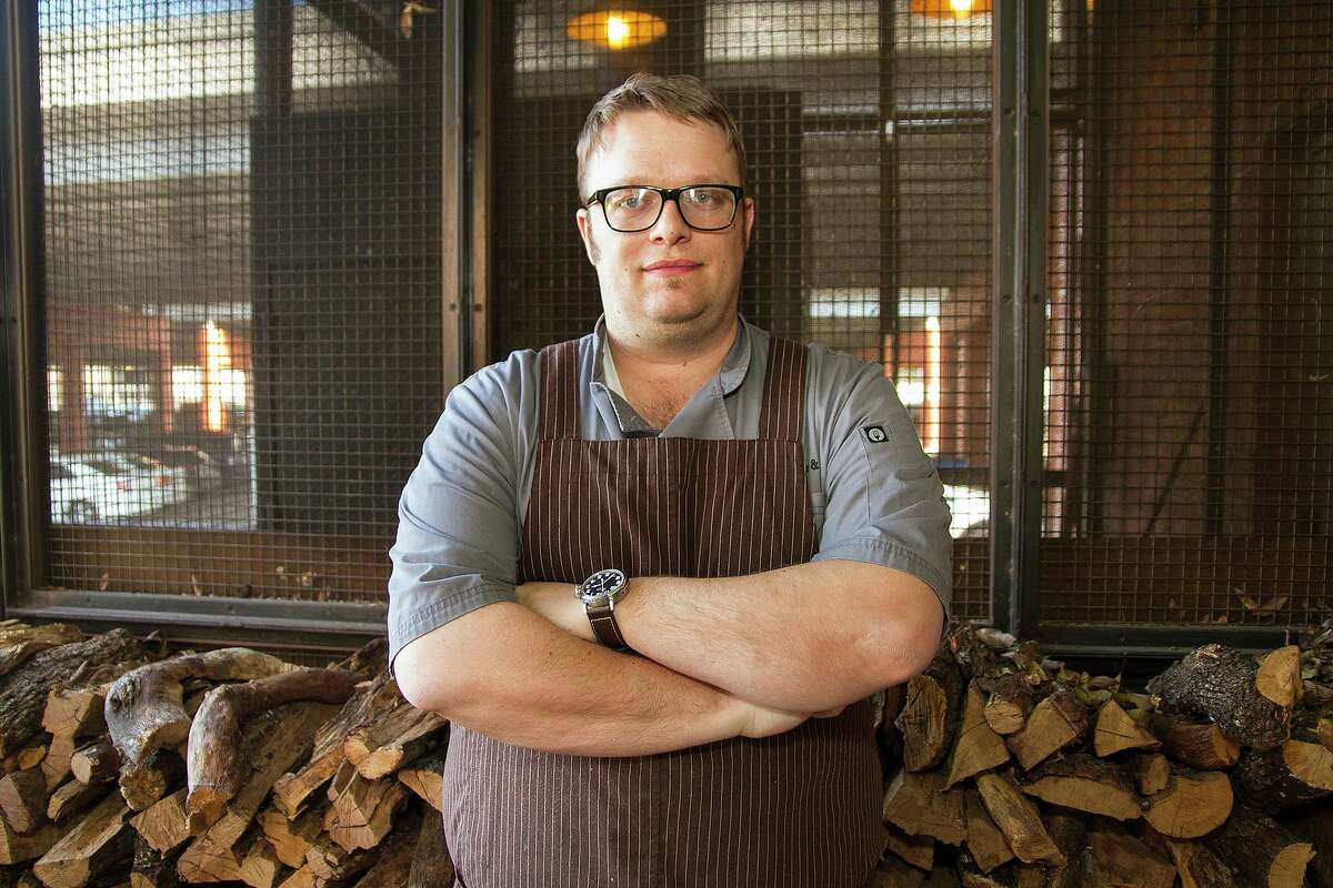 Tim Rattray, chef and owner of The Granary ' Cue & Brew at the Pearl, filed bankruptcy for himself and two restaurant companies Tuesday. He is pictured in front of the restaurant's barbecue pit in 2016.