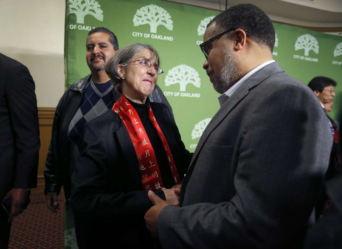 Anne Kirkpatrick meets with Anthony Finnell, Sr., Executive Director of the Citizens' Police Review Board, after she was introduced as the new Oakland police chief at a news conference in Oakland, Calif. on Wednesday, Jan. 4, 2017.