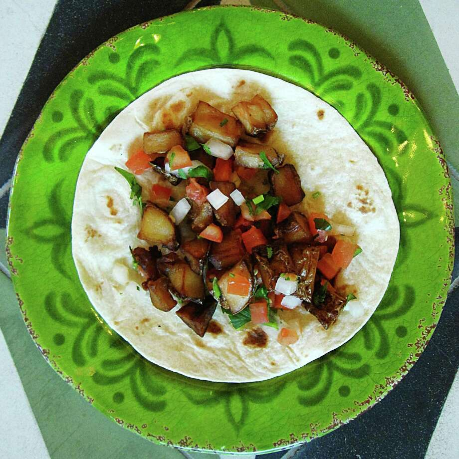 Papas ranchera taco on a flour tortilla from El Mirador on South St. Mary's Street. Photo: Mike Sutter /San Antonio Express-News