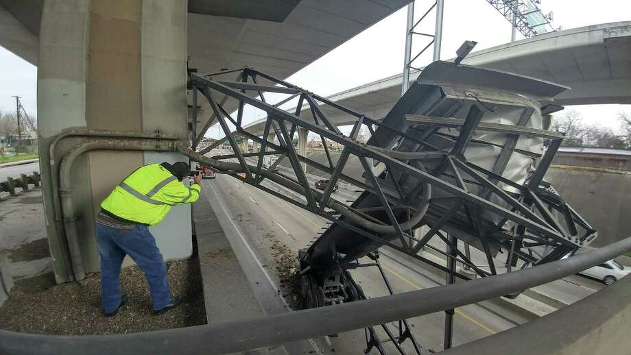 The lower level of Interstate 10 near Cincinnati Avenue is closed Wednesday morning after an 18-wheeler struck a large traffic sign, according to the Texas Department of Transportation. The crash occurred shortly before 8:30 a.m. Wednesday, where an 18-wheeler reportedly destroyed a sign in the eastbound lanes that was above the lower lanes of I-10, said TxDOT spokesman Josh Donat. Photo: John Tedesco, Staff Photographer