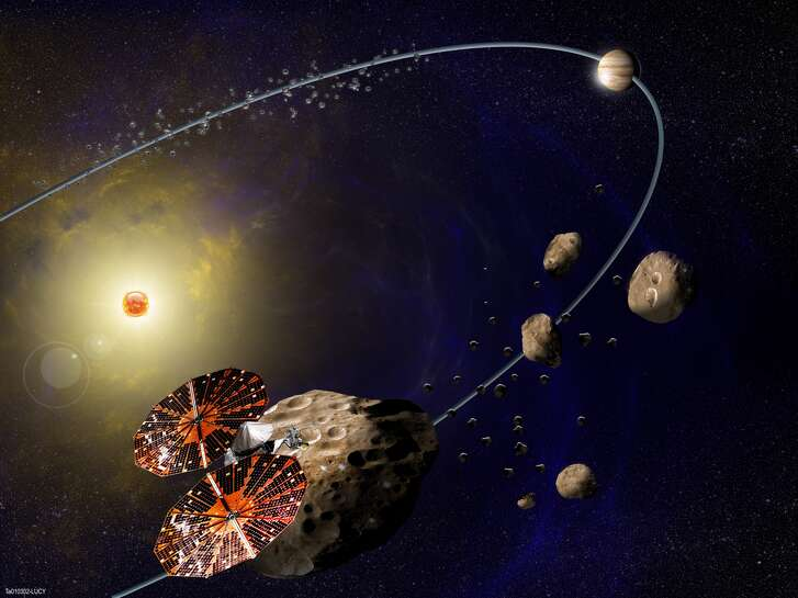 Southwest Research Institute is leading NASA's Lucy mission, which will launch in 2021 for the first reconnaissance of the Trojans, a population of primitive asteroids orbiting in tandem with Jupiter. In this artist's concept (not to scale), the Lucy spacecraft is flying by Eurybates, one of the six diverse and scientifically important Trojans to be studied.