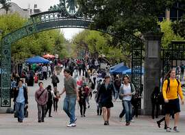 Students walked through Sather Gate on their way to classes Tuesday. The University of California released information about the incoming freshman class Tuesday April 17, 2012.  The results show an increase in out-of-state and foreign students, who pay a much greater tuition cost to the cash strapped university system.