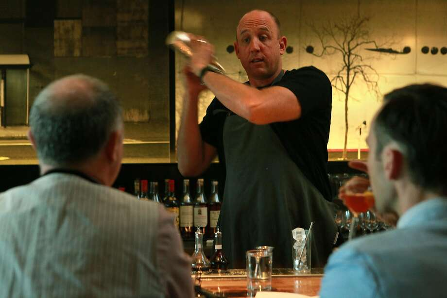 Thad Vogler, Bar Agricole co-owner, mixes drinks at the bar in 2010. Photo: Liz Hafalia, The Chronicle