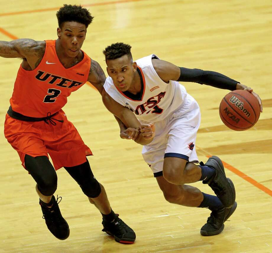 UTSA's Gino Littles looks for room around UTEP's Omega Harris during first half action Sunday Jan. 1, 2017 at the Convocation Center. Photo: Edward A. Ornelas, Staff / San Antonio Express-News / © 2017 San Antonio Express-News