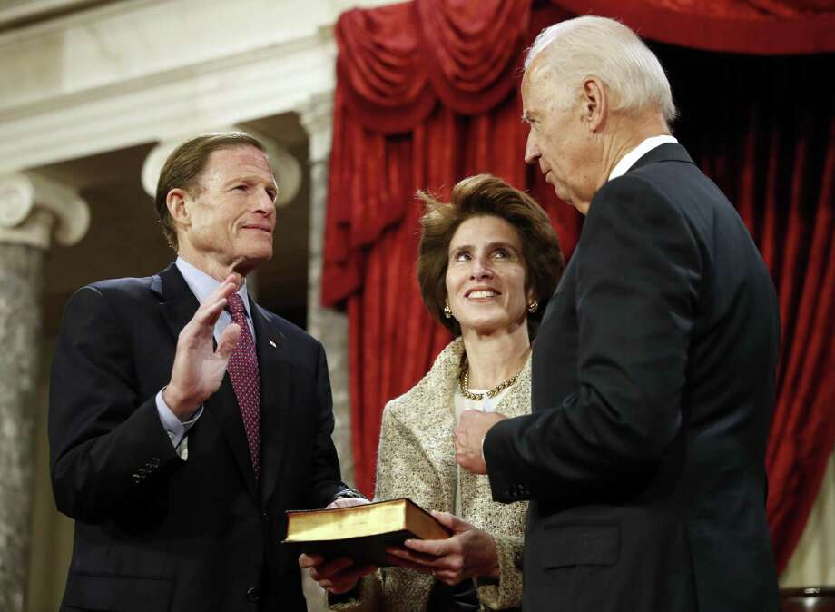 Vice President Joe Biden, right, administers the Senate oath to Sen. Richard Blumenthal, D-Conn., with his wife Cynthia Malkin holding a Bible, during a mock swearing in ceremony in the Old Senate Chamber on Capitol Hill in Washington, Tuesday, Jan. 3, 2017, as the 115th Congress begins. Photo: Alex Brandon / Associated Press / Copyright 2017 The Associated Press. All rights reserved.