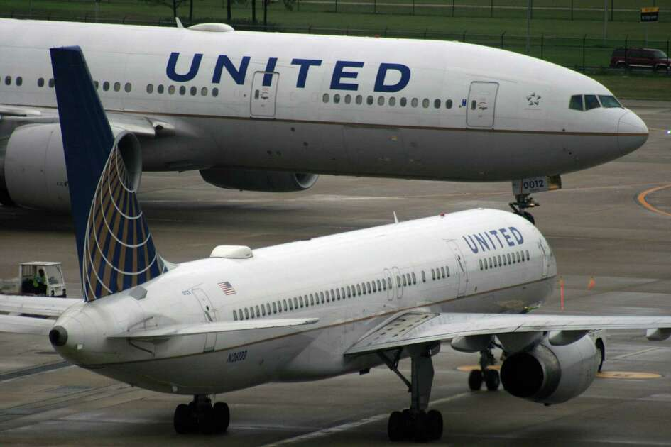 A United Airlines Boeing 777 passes in front of a United Airlines Boeing 757 at Bush Intercontinental Airport in December 2016.
