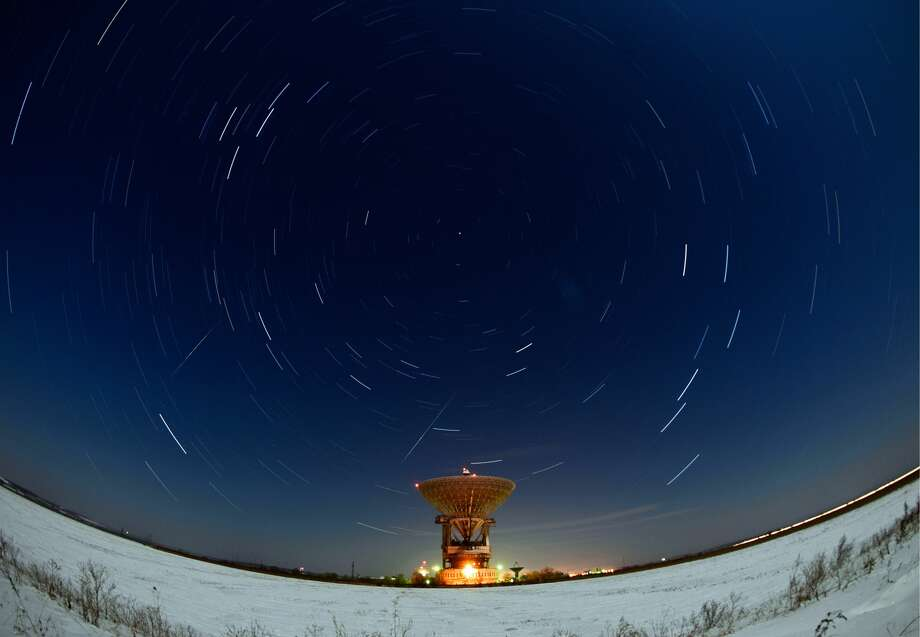 PRIMORYE TERRITORY, RUSSIA - DECEMBER 15, 2016: Meteors streak across the night sky over the Galenki RT-70 radio telescope at a Kvant-D command and measurement complex which is part of the Titov Main Space Test Centre, during the Geminids meteor shower. The Quadrantids meteor shower, which is typically one of the more remarkable shooting star displays of the year, will peak on January 3. The most meteors will be visible overnight between January 3 and 4. Photo: Yuri Smityuk/Yuri Smityuk/TASS